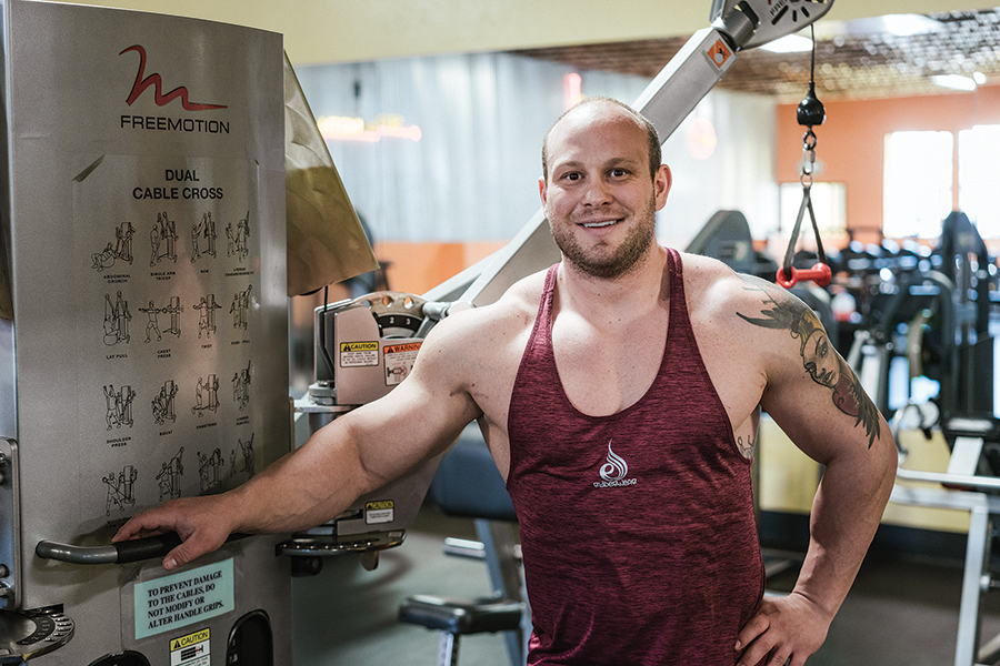 SOBER AND FIT: Tahoe City native Ben Florsheim was addicted to drugs for seven years but became clean after overdosing on heroin 10 years ago. Now a lifestyle coach, he focuses on healthy living and fitness, and works out daily. Photo by Wade Snider/Moonshine Ink